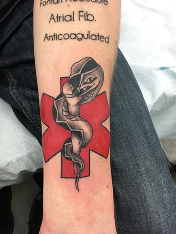 medical alert tattoo calgary, canada strange world tattoo