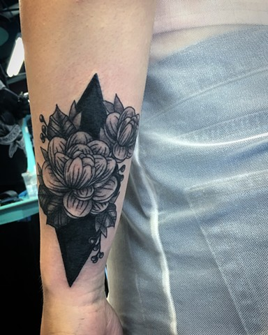 line-work flower tattoo