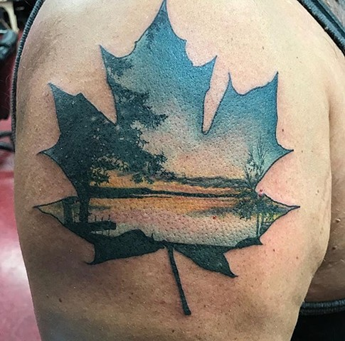 Maple leaf colour tattoo Strange World Tattoo Calgary, Canada