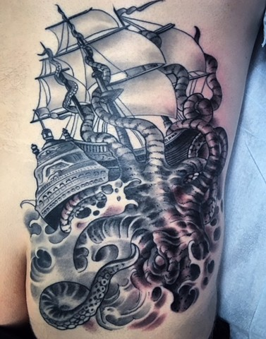 black and grey pirate ship tattoo by artist Brett Schwindt of Strange World Tattoo in Calgary