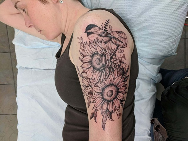 flowers and bird tattoo strange world tattoo Calgary