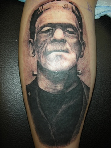 Frankenstein tattoo in black and grey
