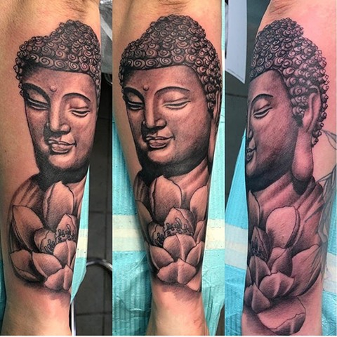 Buddha and Lotus flower tattoo in black and grey Strange World Tattoo Calgary