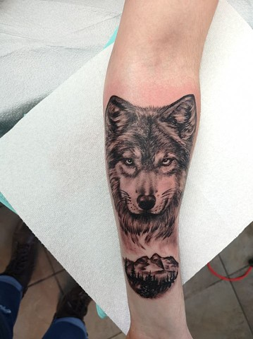 b176340c4 ... strange world tattoo calgary · wolf portrait in black and grey
