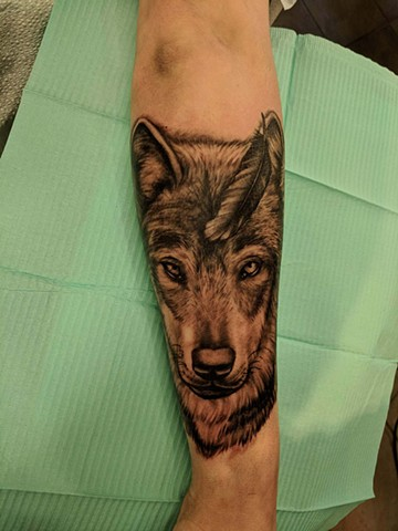 wolf and feather tattoo strange world tattoo