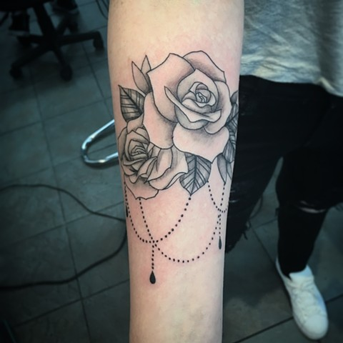 black and grey rose tattoo at Strange World Tattoo in Calgary, Alberta