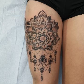 Beautiful Mandala Tattoo on upper thigh at strange world tattoo calgary, alberta