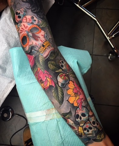 Full colour sleeve of sugar skulls by Brett Schwindt at Strange World Tattoo