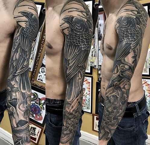 Raven tattoo sleeve in black and grey strange World Tattoo Calgary Alberta Canada