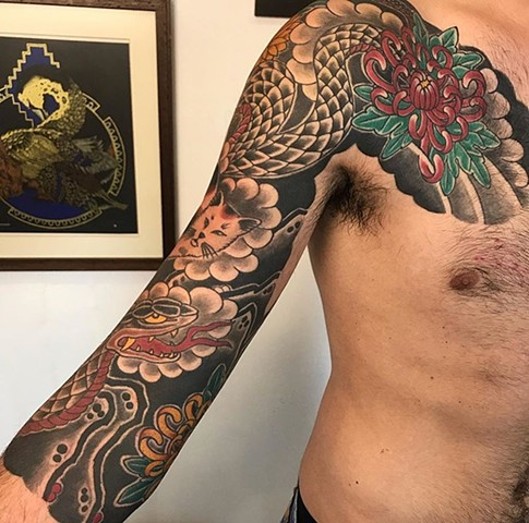 Japanese snake sleeve tattoo with chest panel strange world tattoo calgary alberta canada tattoo artist's japanese tattoos