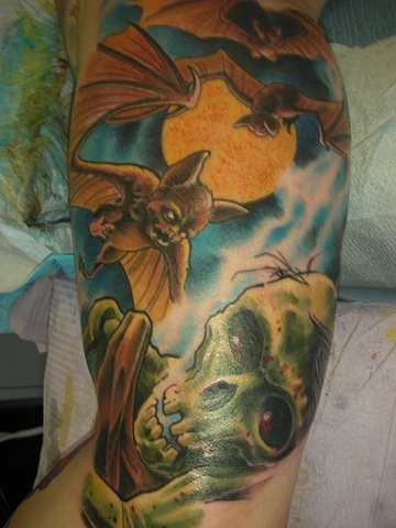 Tattoo of zombie and bats