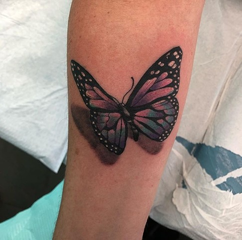 Butterfly tattoo Strange World Tattoo Calgary
