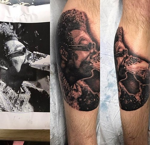 Kramer portrait tattoo in Black and grey Strange World Tattoo Calgary