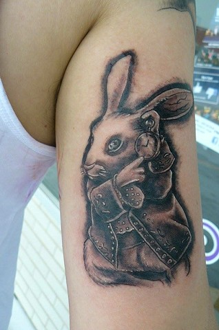 white rabbit Alice in Wonderland tattoo strange world tattoo