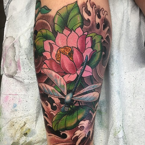 Colour dragonfly and flowers with black and grey background tattoo by artist Brett Schwindt at Strange World Tattoo in Calgary, Canada