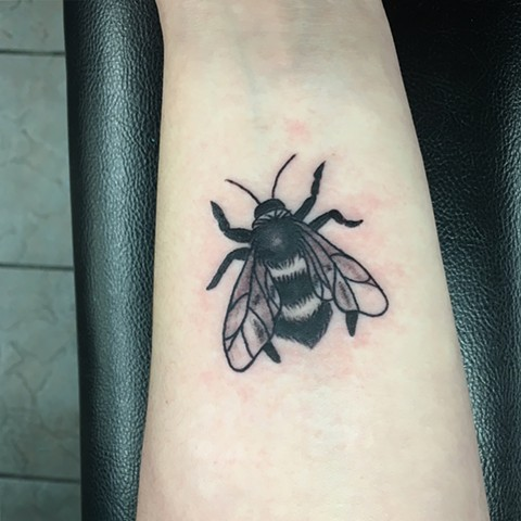bumblebee tattoo Calgary, Alberta Strange World Tattoo