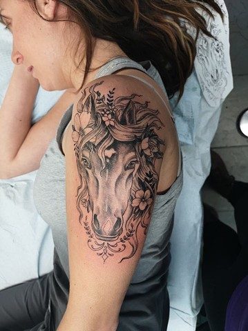 horse head tattoo with beautiful flowers in black and grey strange world tattoo calgary