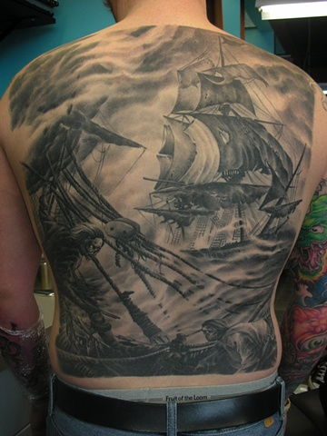 Black and grey tattoo backpiece of ships