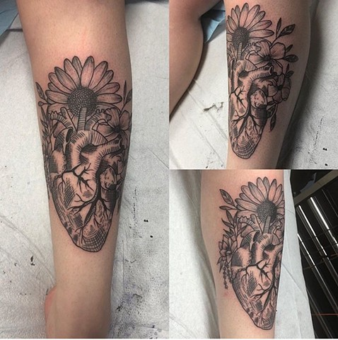Blackwork heart and flowers tattoo Strange World Tattoo Calgary Canada