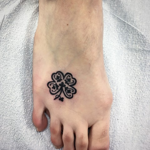 four leaf clover tattoo at Strange World Tattoo in Calgary