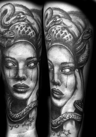 black and grey Medusa head tattoo Strange World Tattoo in Calgary, Alberta