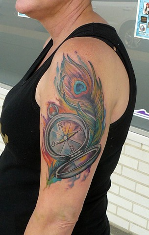 watercolour peacock feather and compass tattoo strange world tattoo calgary