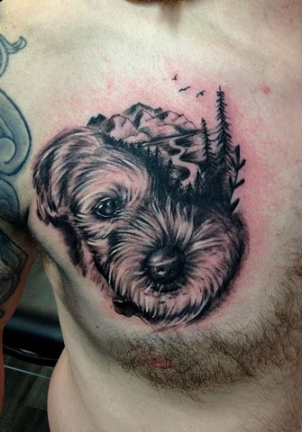 black and grey dog portrait mountain tattoo trees strange world tattoo calgary