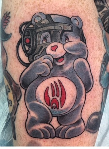 Tattoo artist Brett Schwindt of Strange World Tattoo Care Bear tattoo