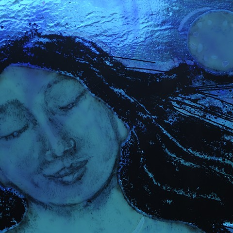 Glass painting of woman and moon