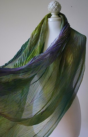 Shibori dyed silk scarves in  shades of green and purple