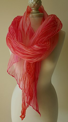 Shibori dyed silk scarf in shades of pink and coral