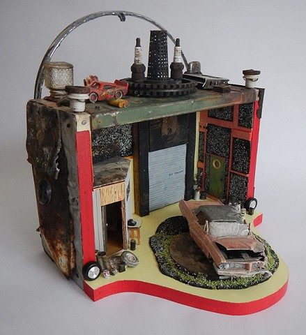 Diorama assemblage of found objects, wrecked model car
