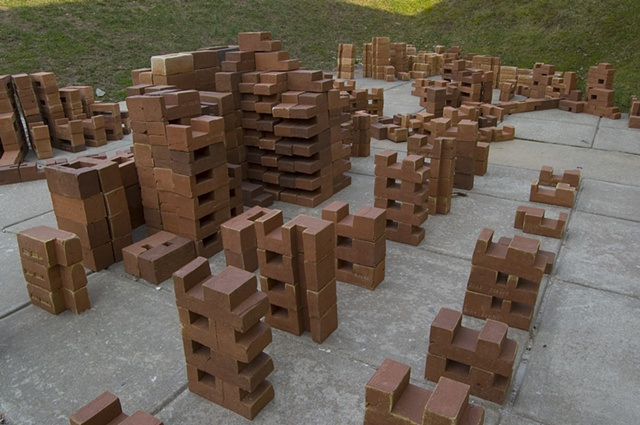 This variation of %Converge% is sited outdoors at the Mainline Art Center, Haverford, PA and is composed of 912 modular bricks in 211 variations and 9 permutations.