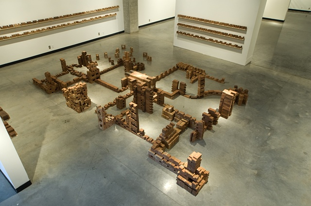 %Converge% is a two-part installation composed of 1123 modular bricks.