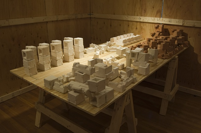 %Development%, sited at Baltimore Clayworks, denies the context of the gallery by framing out the space with plywood and 2x4s.