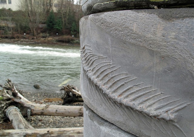 cast concrete columns along Whatcom Creek mark an ancient midden and municipal landfill in Bellingham WA