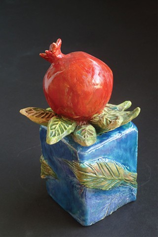 Pomegranate on Blue Box