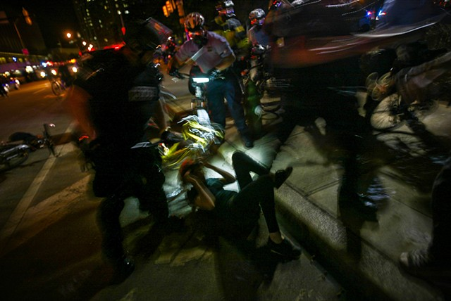 Police detain a protestor during night time demonstrations while the global G20 Summit was held in Pittsburgh, Pa. in Sept. 2009.