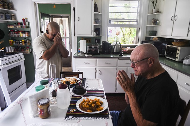 Mulligan and Correa spend a moment before sitting down to a meal July 22, 2014. (click to read caption)