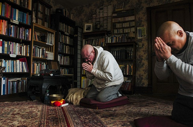 John Mulligan, known as his Buddhist name Sivali, 76, left, and Angel Correa, called Rahula in his formal Buddhist name, 42, right, begin their daily meditation on March 18 2014 at Bodhi House in Mount Joy Township. Mulligan has dedicated to helping teach
