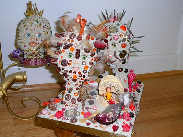 "jenniferbeinhacker.com ""garden art"" ""art in a garden"" garden assemblage ""plant stand"" grout ""Barbie dolls"" ""doll hands"" doll heads"" teeth ""false teeth"" feathers ""baby dolls"" ""king cake dolls"" birds feathers ""self taught"" ""acrylic painting """"acrylic paint"""