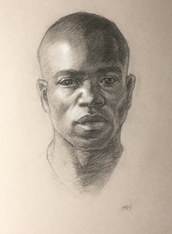 Charcoal portrait drawing on paper