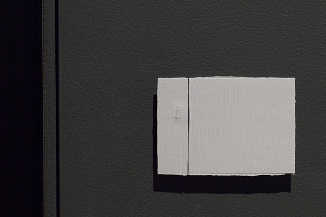 Thick paint covers a single staple on the floor, rendering it near invisible