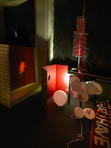 Ghost Bear projection with Soviet flag and deflated USSA balloons