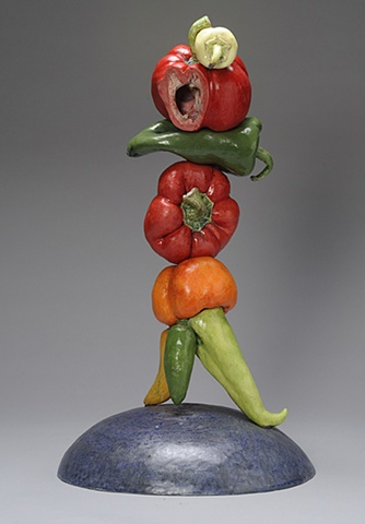 ceramic figure composed of peppers by Linda S Fitz Gibbon