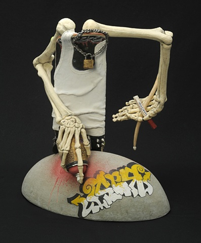 trompe l'oeil ceramic skateboard figure with spray paint graffiti by Linda S Fitz Gibbon