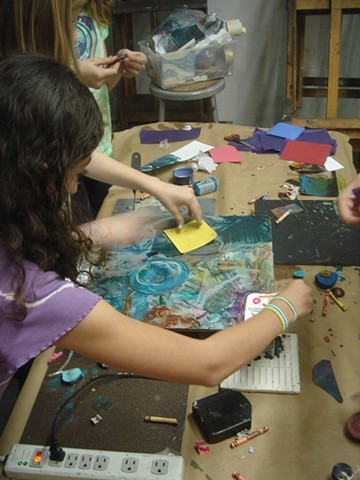 kids making monoprints on a hot palette