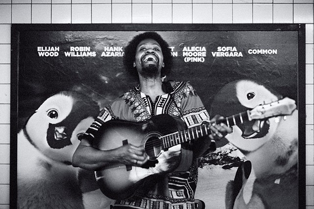 Photograph of a Guitarist with Penguins, 14th Street Subway Station, Manhattan, NY, by Judith Ebenstein