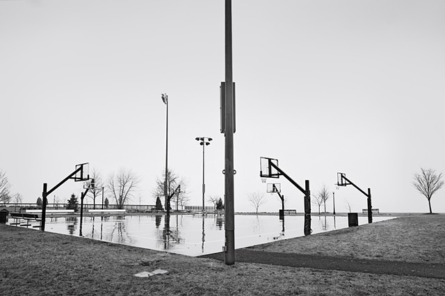Photograph of a basketball court in the rain, Scenic Hudson Park, Irvington, NY, by Judith Ebenstein