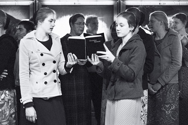 Photograph of a Christian Chorus, Times Square Subway, Manhattan, New York, by Judith Ebenstein